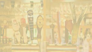 beer taps photo with yellow tint
